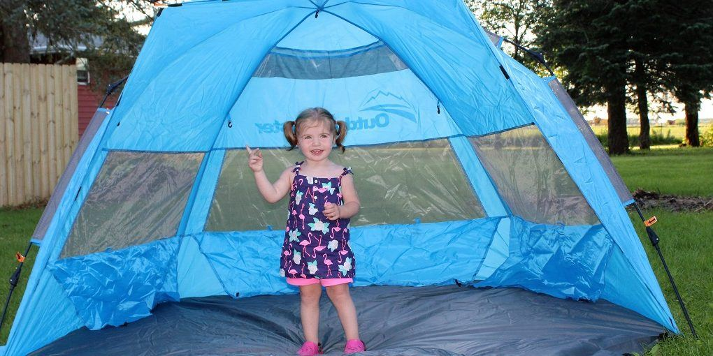 Baby girl standing in an outdoor beach tent  sc 1 st  Mom Loves Best : baby shade tent uv protection - memphite.com