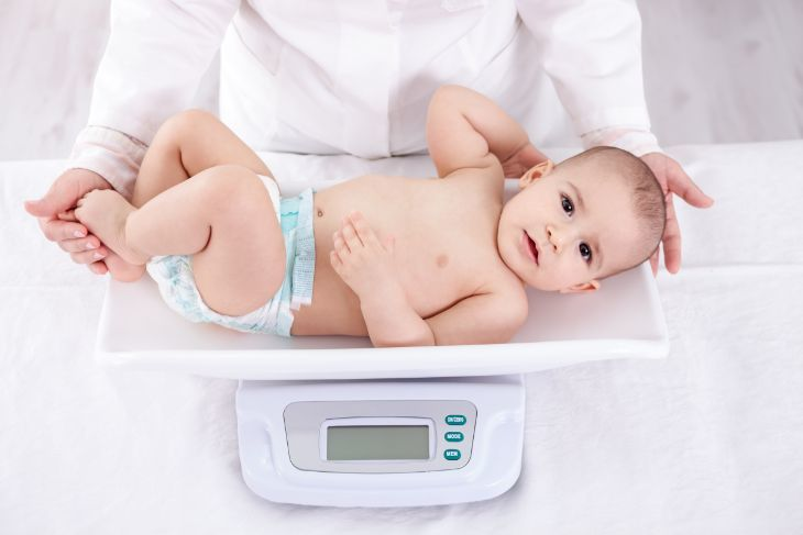 Baby boy being weighed on a scale