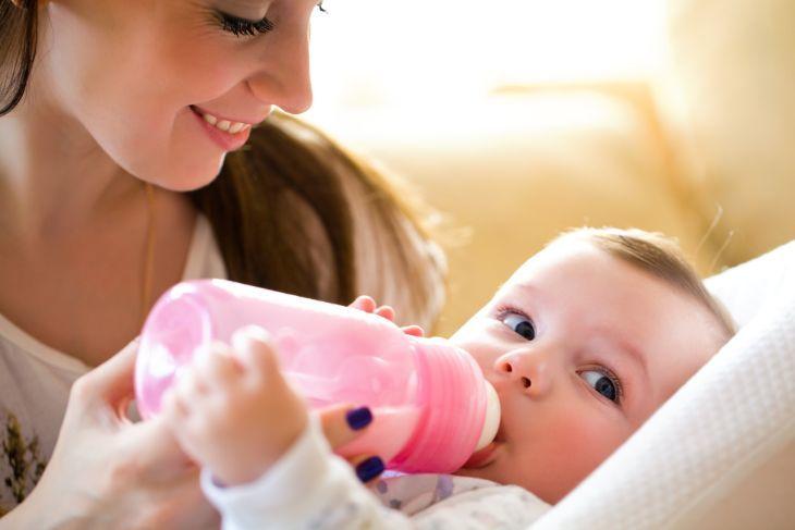 Mother bottle feeding her baby