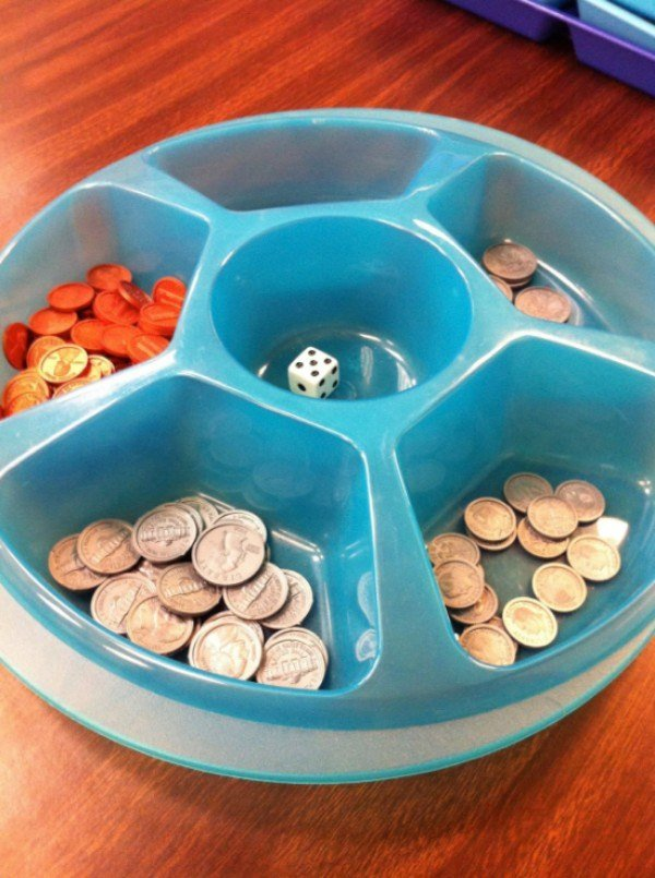 Kids roll the dice and get the corresponding amount of pennies and/or a nickel. First person to 25 cents wins! For older kids add some more dice and let them trade smaller coins for quarters in the race to one dollar. Find the snack divider at the dollar store.