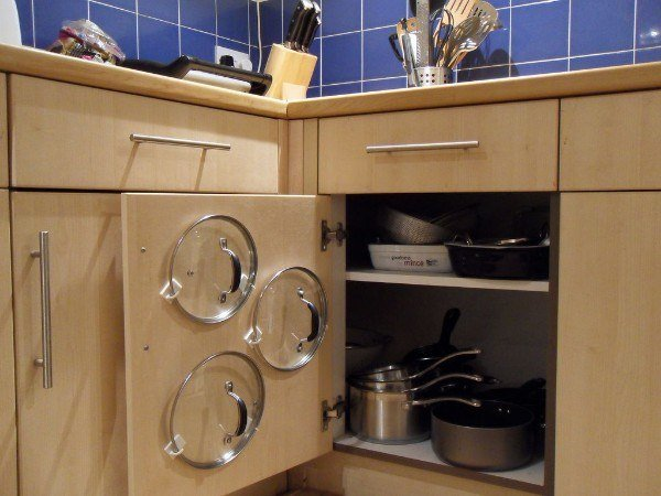 Take over unused space by using Command Hooks to store the lids to your pots and pans.