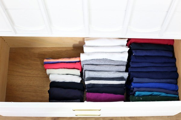 Did you know you can fold t-shirts so they can STAND UP? Not only can you see all of your clothes at once, it also maximizes space.