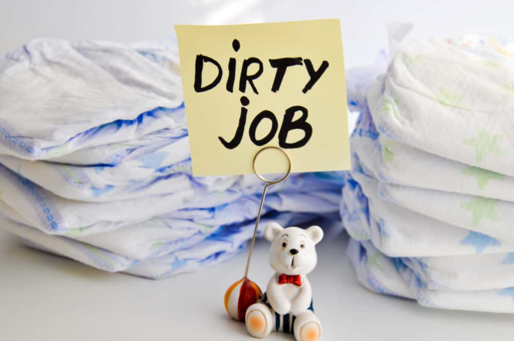 "Stack of disposable diapers with a sign that reads ""Dirty Job"""