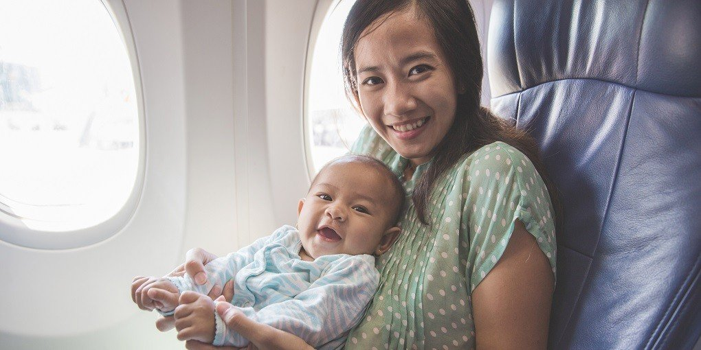 Breast Pumping Mother and baby in airplane