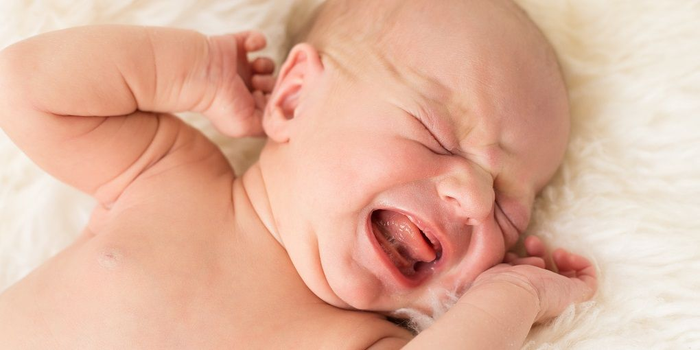 Constipated newborn baby crying