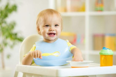 Young baby sitting in a high chair