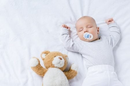 Baby sleeping while using pacifier