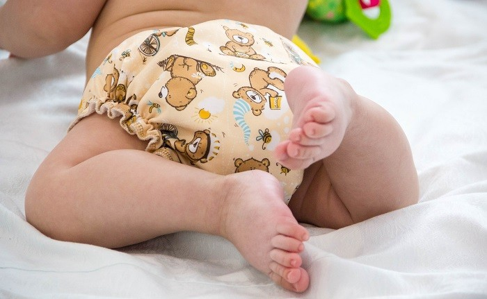Baby wearing cute cloth diapers