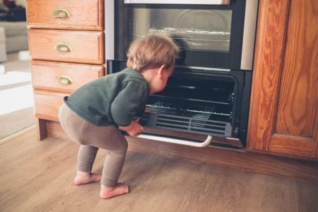 Baby looking inside the oven