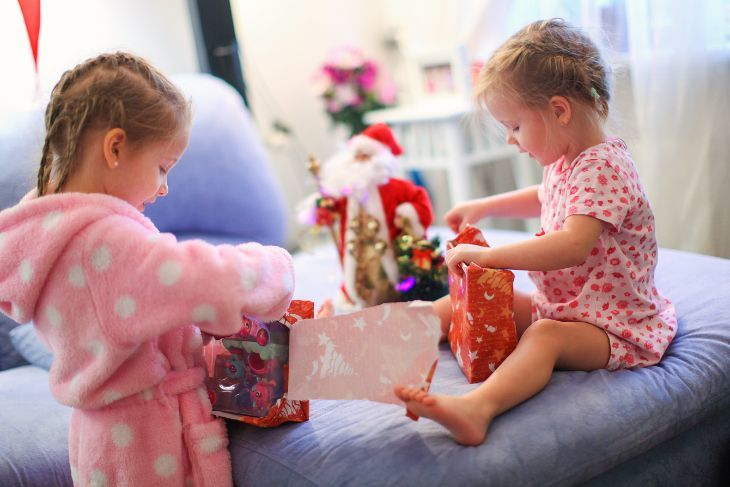 Two Little Girls Opening Their Christmas Gifts