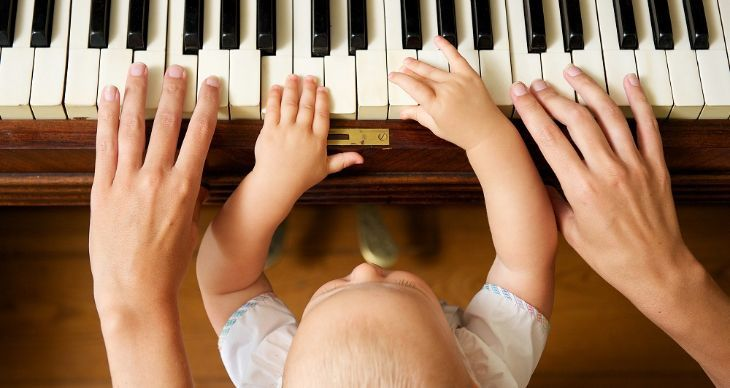 Baby Playing Piano With Mother