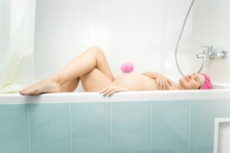 Pregnant woman taking a bath