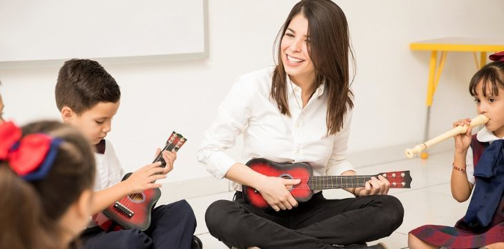 Kids playing music instruments in school