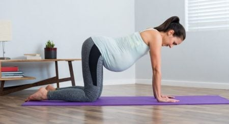 The Benefits of Prenatal Yoga During Pregnancy (& How to Do It)