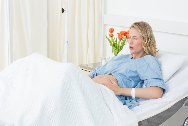 Pregnant woman laying in hospital bed
