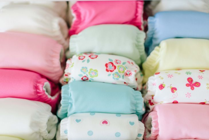 Organized pile of cloth diapers