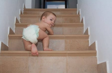 Toddler climbing up the stairs unsupervised