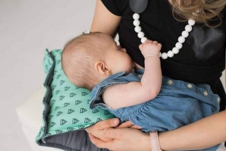 Mother breastfeeding her baby wearing a nursing dress
