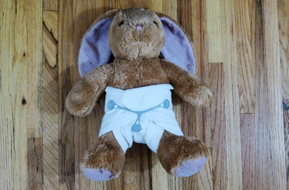 Stuffed rabbit wearing a cloth diaper