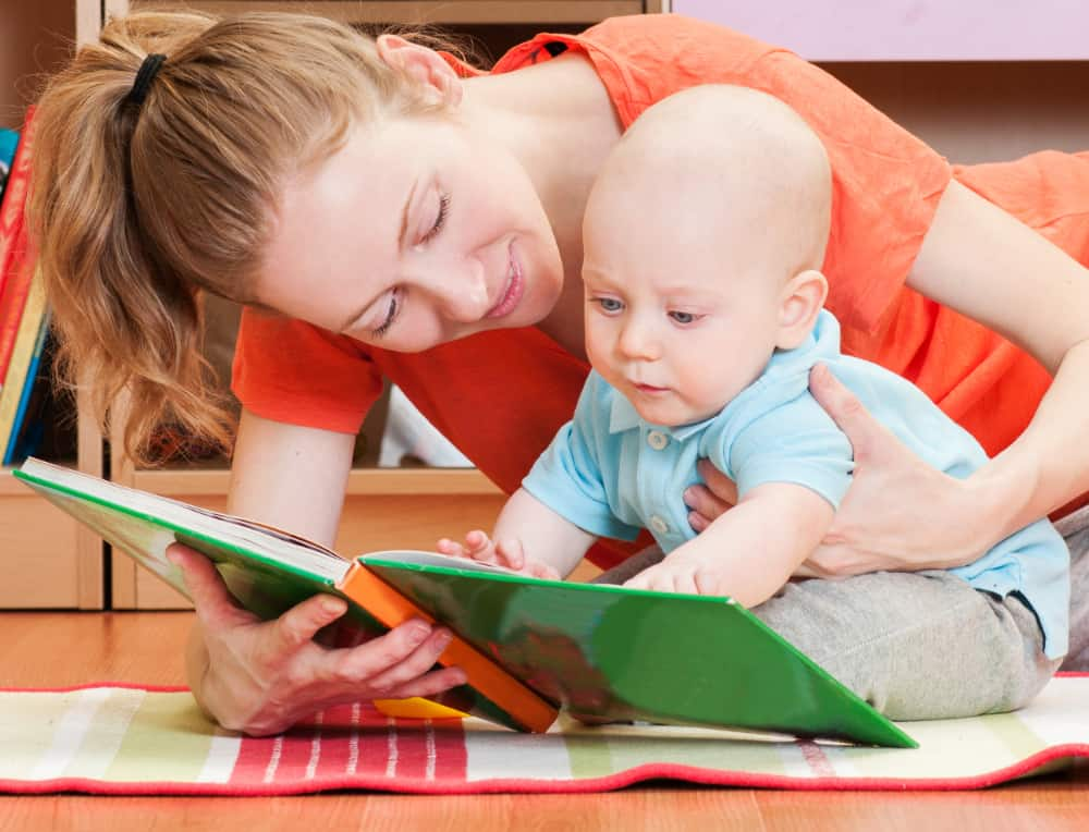 Mother reading to infant