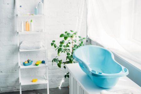 Bathroom with baby stuff and bathtub