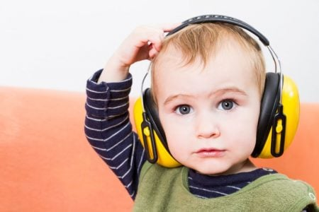 toddler wearing headphones
