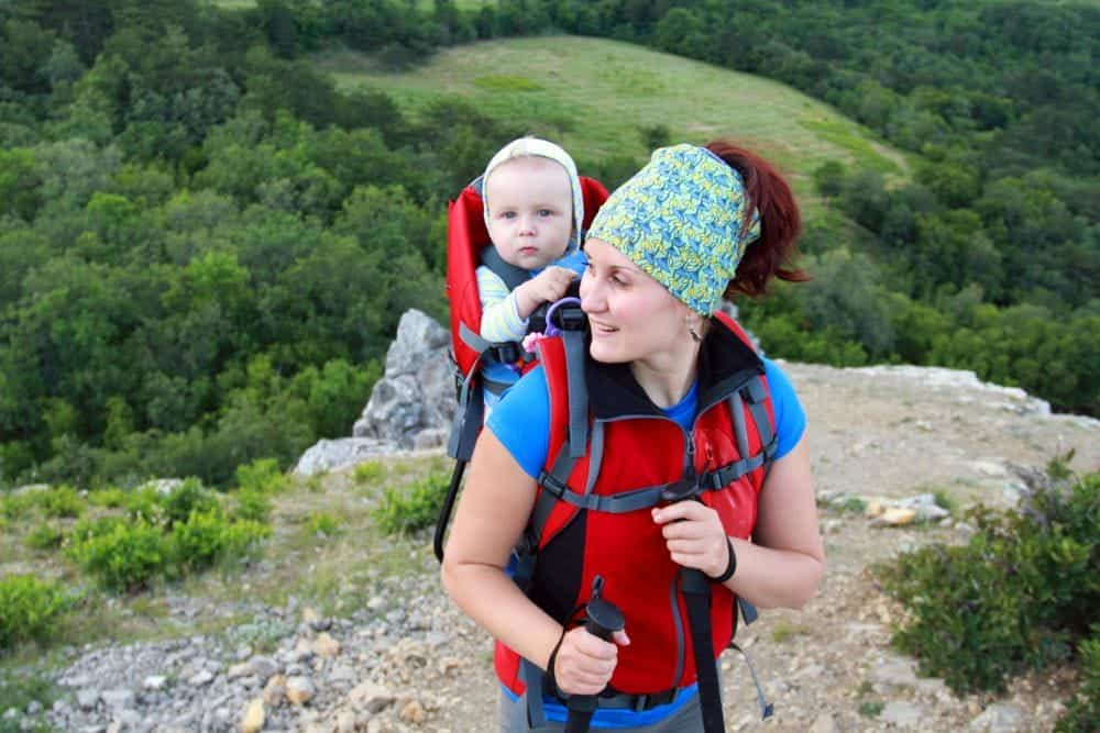 Mom carrying baby in a hiking carrier