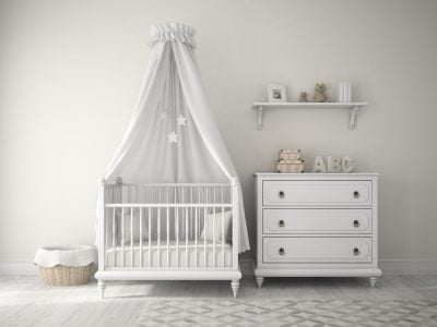 Photo of a baby nursery with a laundry hamper