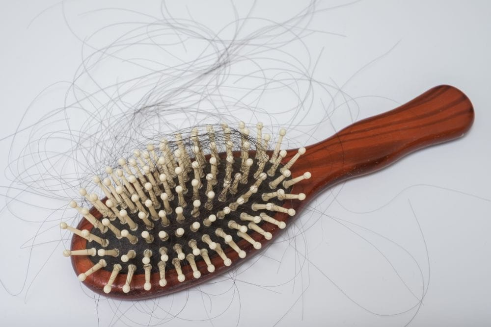 Hair brush with postpartum woman's hair