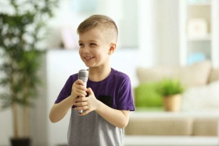 Little boy holding a karaoke mic