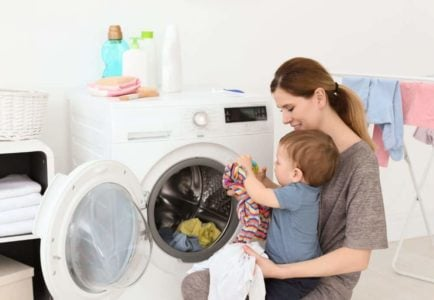Mom and baby doing laundry