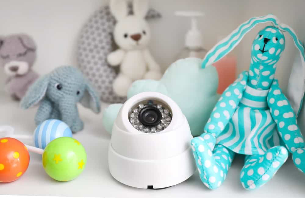 Baby monitor surrounded by stuffed animals