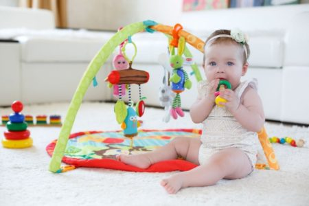 Baby girl playing with activity center
