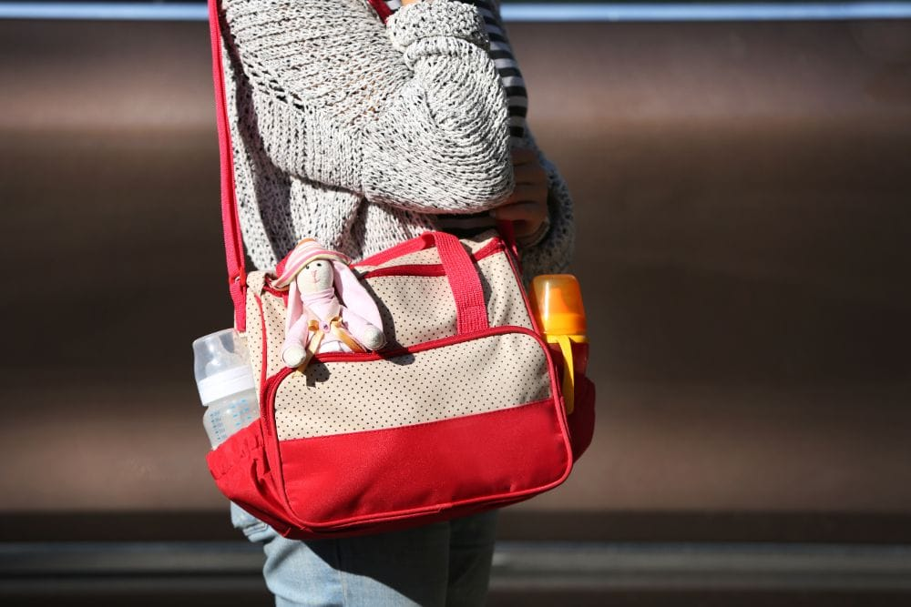 Woman carrying a diaper bag