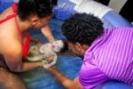 Woman delivering water birth