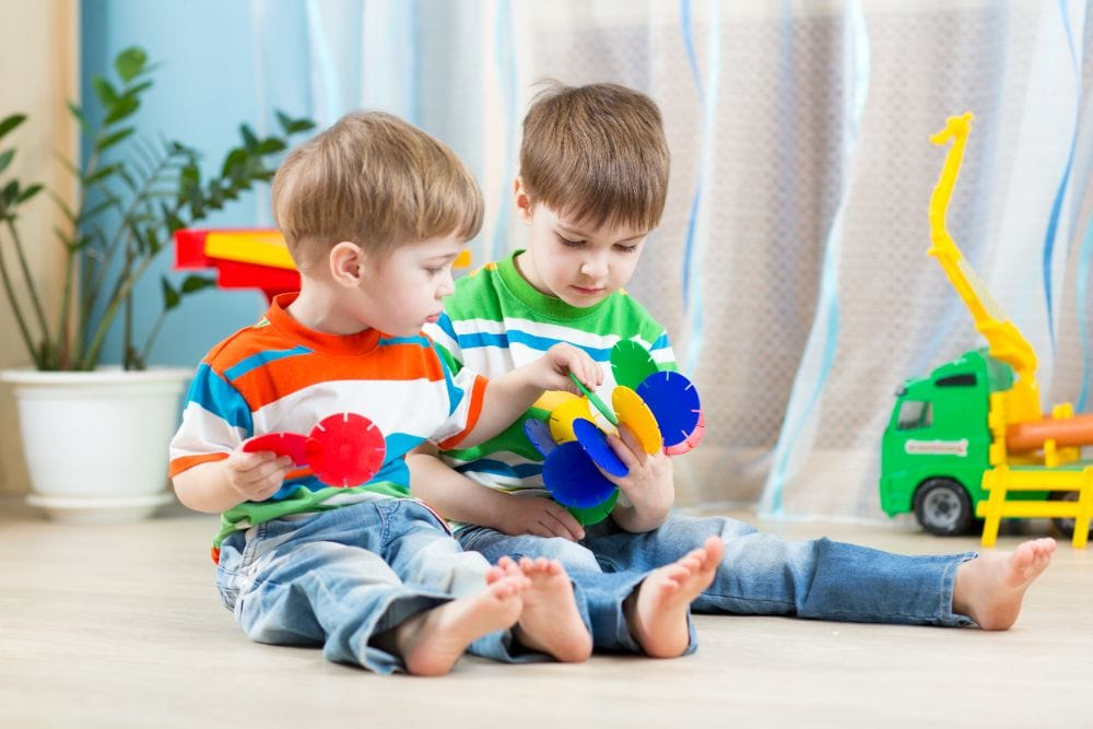 Two small boys playing with educational toy