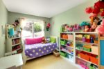 Kids bedroom with toys in shelves