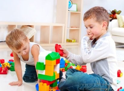 Two little boys playing Legos together