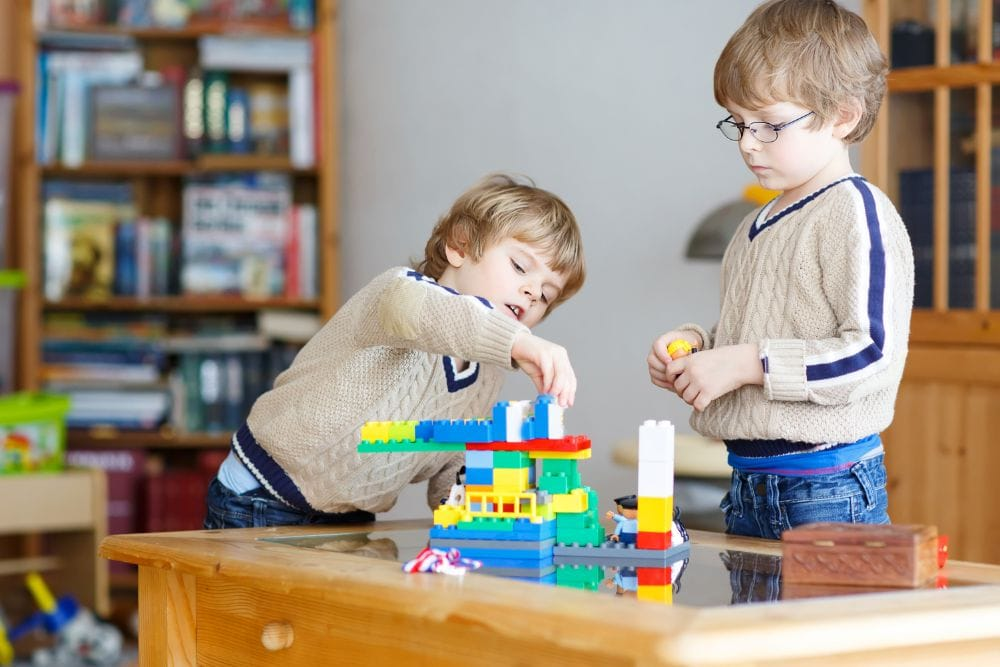 Little boys building a lego construction together