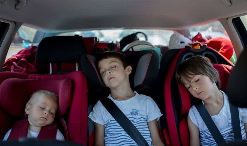 3 Siblings sleeping in their car seats