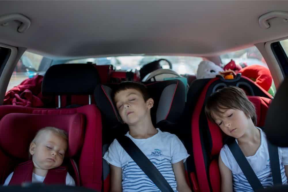 3 Siblings sleeping in their car seats