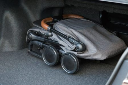 A folded stroller in the trunk of a car