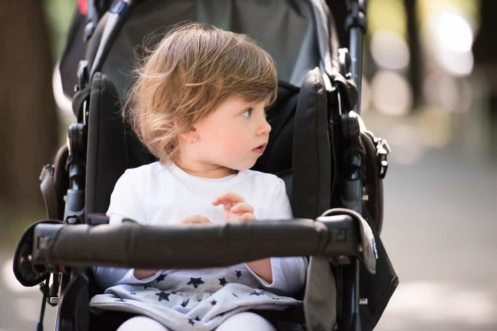 Toddler girl sitting in a stroller