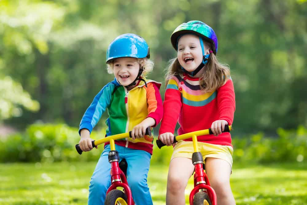 Kids riding bikes wearing best bike helmets