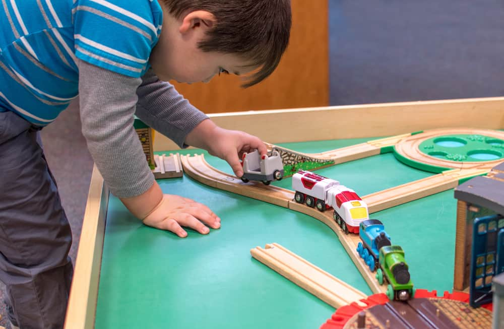 Young boy playing with the best train table