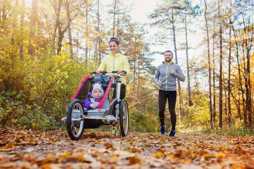 Parents with a jogging stroller