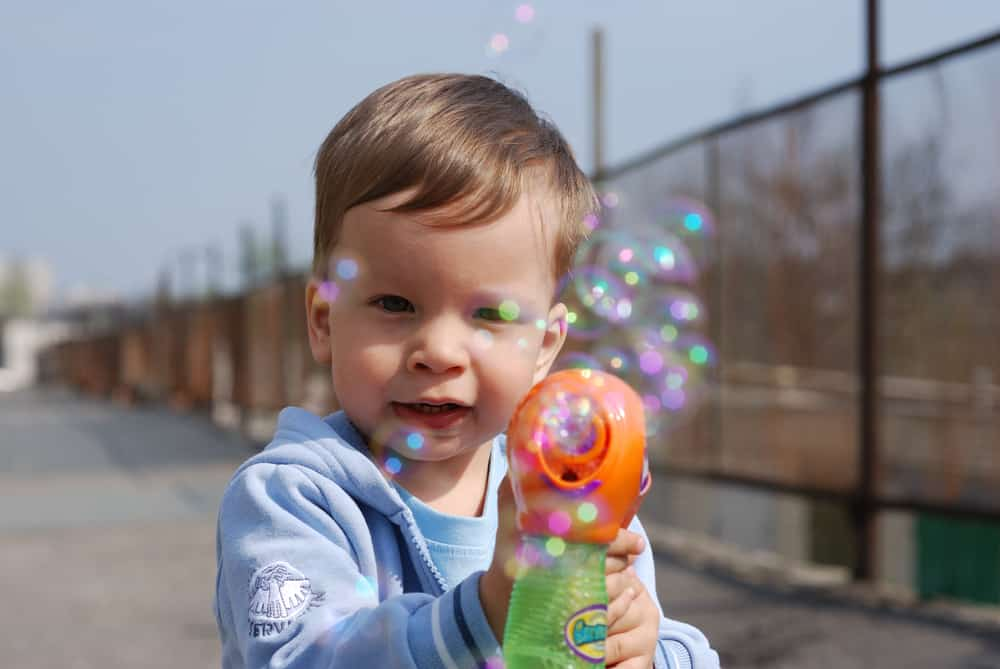 Small boy playing with bubble toy