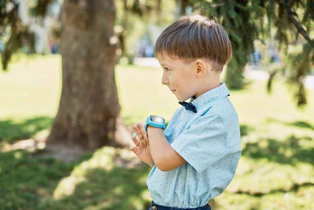 Young boy with gps smartwatch