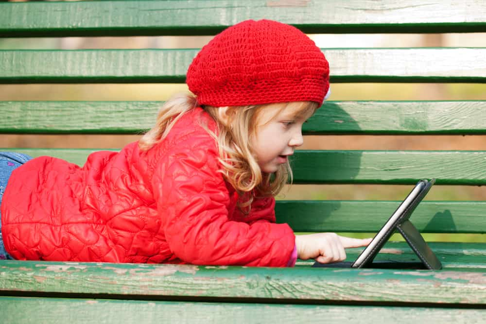 Young girl playing with ipad