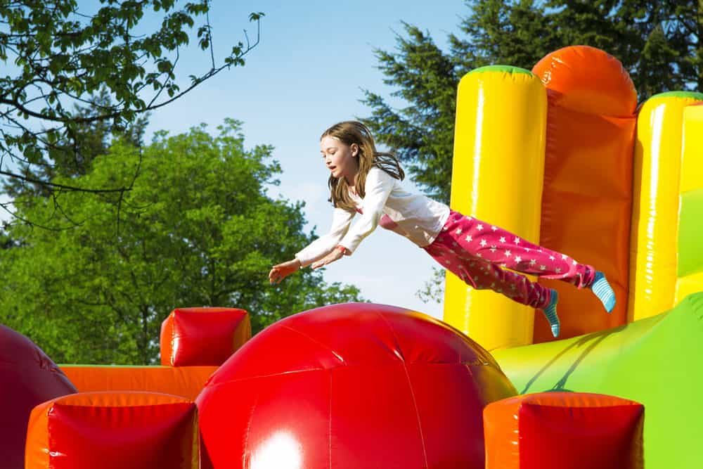 Girl playing in a bounce house